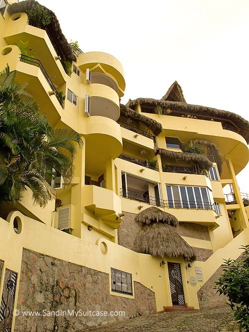 Casa Isabel rises egg-yolk yellow in the hills behind central Puerto Vallarta