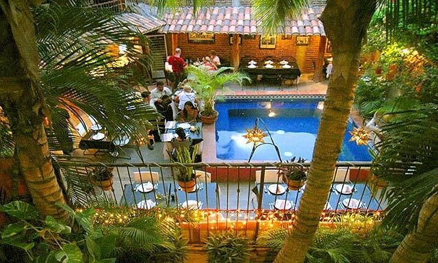 Poolside seating at Salvatore's - credit Siesta Suites