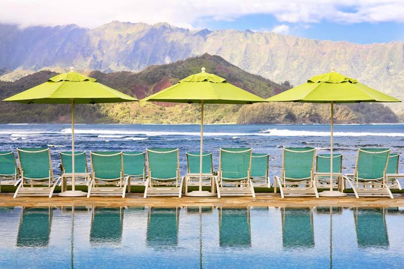 Pool chairs overlooking the ocean at the Princeville Resort, Kauai.
