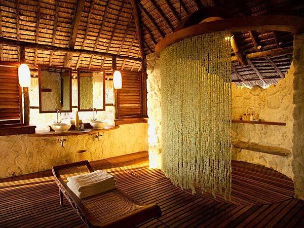 Rustic bathroom - courtesy andBeyond Mnemba Island Lodge