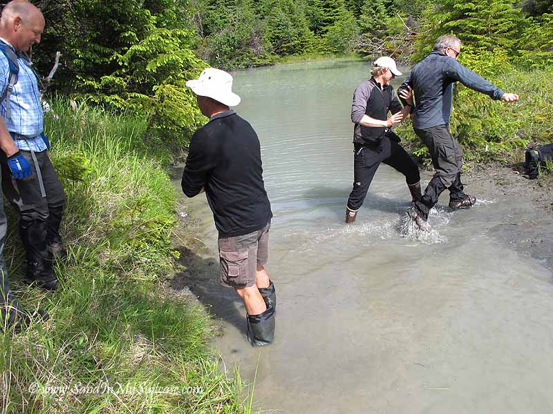 Un-Cruise Adventures Alaska - hiking across a stream