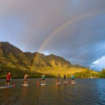 Stand-up paddleboarding along a Kauai river