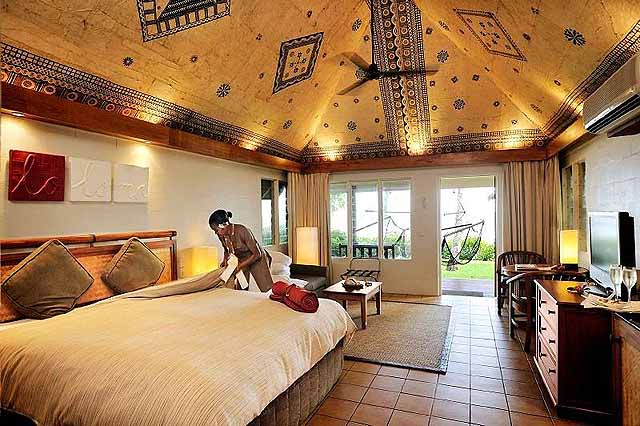 Beach bure with painted tapa-lined ceiling - credit Outrigger on the Lagoon Fiji