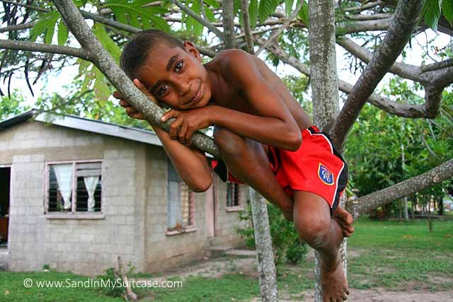 This little Fijian boy in a tree captured our hearts on a visit to a Fijian village