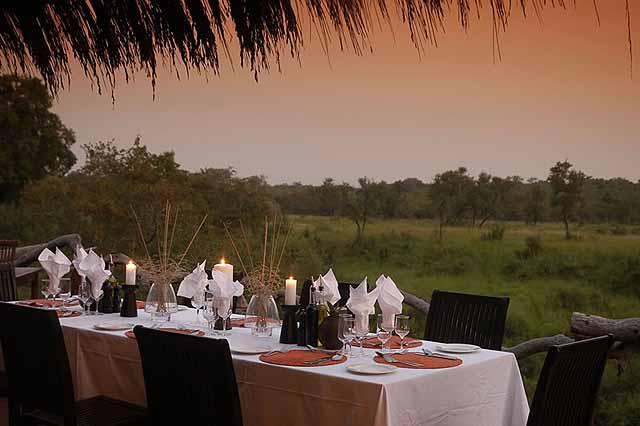 Dinner at dusk - credit Simbambili Game Lodge