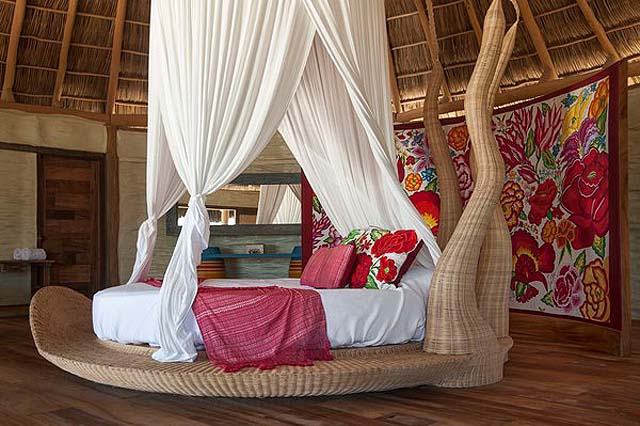 Round beds are works of art in individually decorated palafitos - credit Hotelito Desconocido