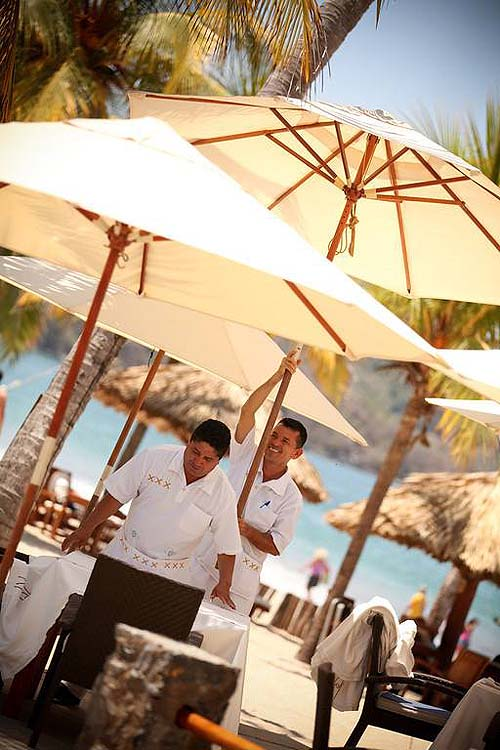 Beach butlers setting up on the beach - photo Viceroy Zihuatanejo