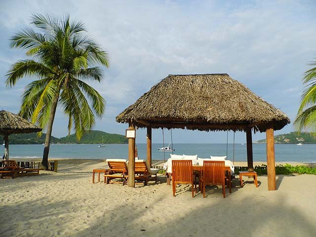 Palapa and chairs - photo Viceroy Zihuatanejo