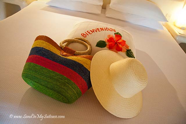 Life's a beach! Welcome beach bag and hat on our bed