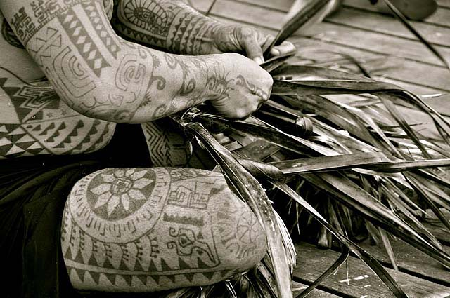 A Tahitian with traditional tattoos - photo Tahiti Tourisme