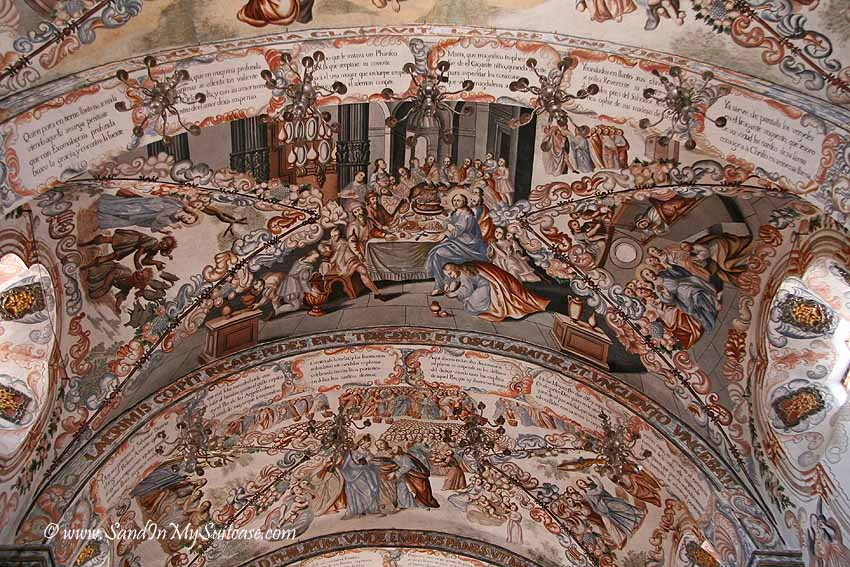 A ceiling cupola completely covered in frescoes