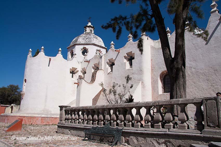 The plain exterior belies the sanctuary's psychedelic interior