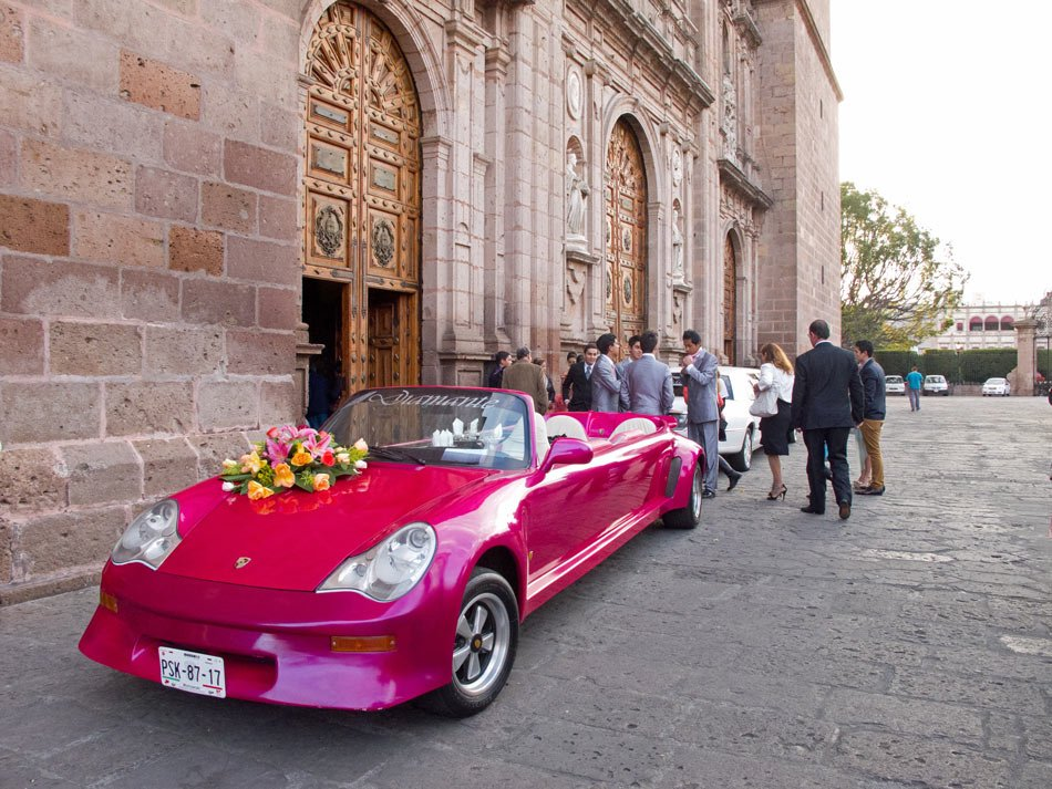 A wedding party gathers in front of the Morelia Cathedral.