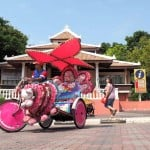 Visiting Malacca's points of interest in a psychedelic trishaw