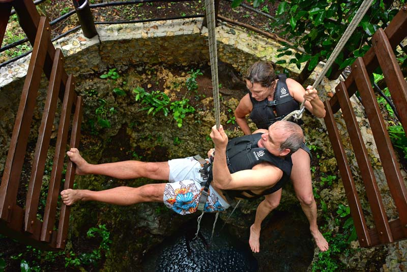 Rappeling down into a Riviera Maya cenote at Native Park Tulum