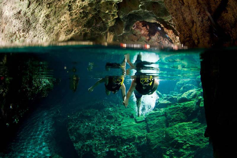 At Cenotes Sac Actun, you can snorkel through underground rivers