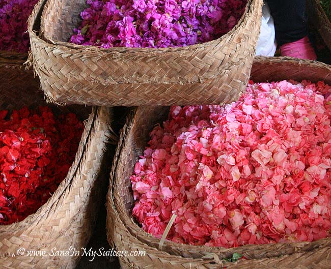 Small weaved trays are sprinkled with flower petals from big baskets like these