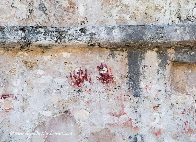 mayan ruins of tulum - red handprints