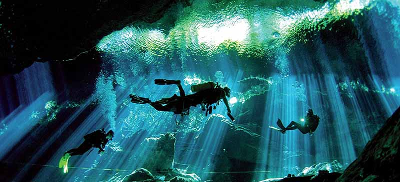 Riviera Maya activities - scuba diving inside a cenote
