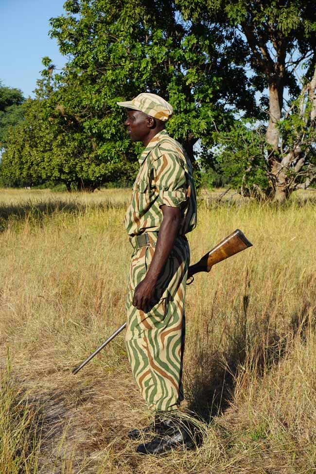 A ranger armed with a high-powered rifle always leads Time+Tide's Zambia walking safaris.