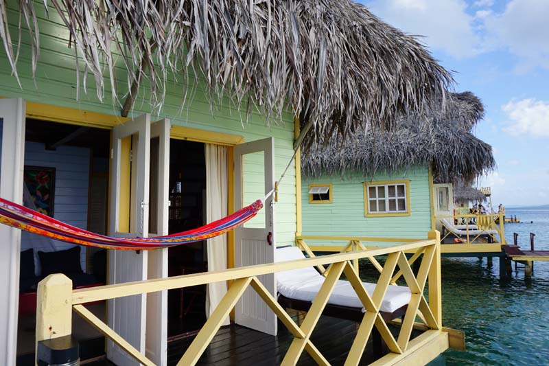 Each bungalow at Punta Caracol Aqua Lodge has a large deck with a ladder leading down into the water