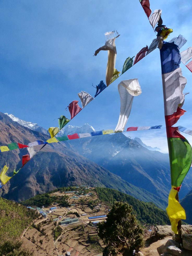 Tibetan prayer flags fly in the wind on the Gokyo Lakes trek.