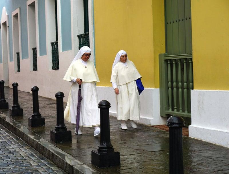 Nuns stroll a street in Old San Juan, Puerto Rico.
