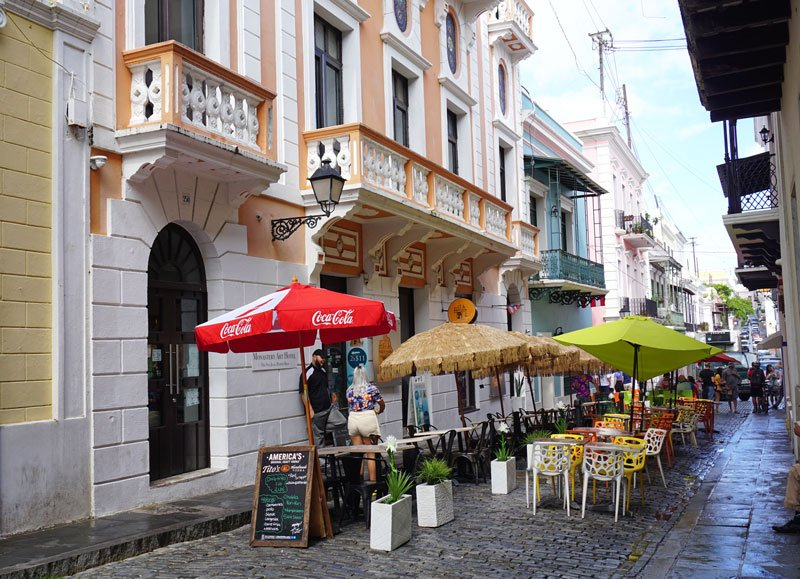 Cobblestone street in Old San Juan with outdoor cafes