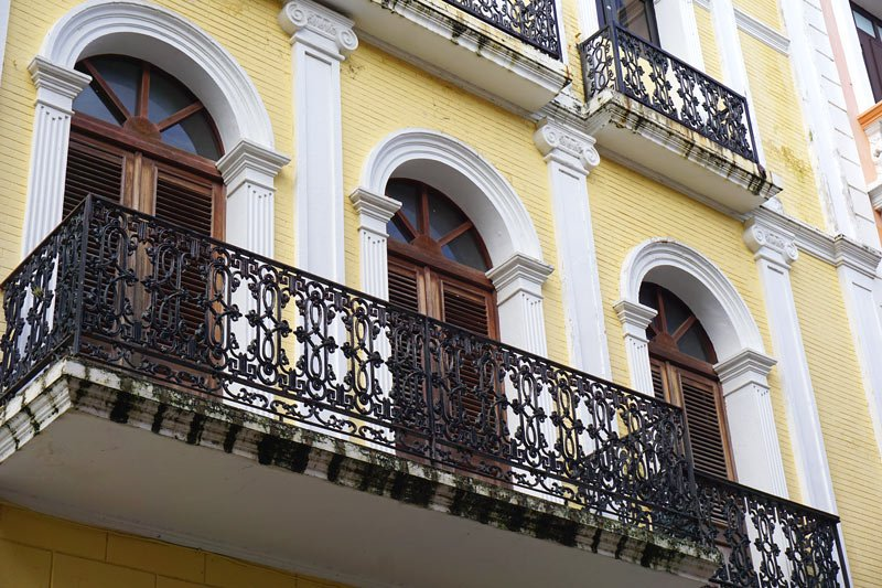 Look at the wrought iron balconies on the buildings when you visit Old San Juan, Puerto Rico.