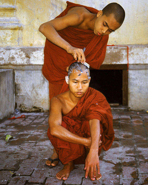 Monk-shaves-another-monk's-head