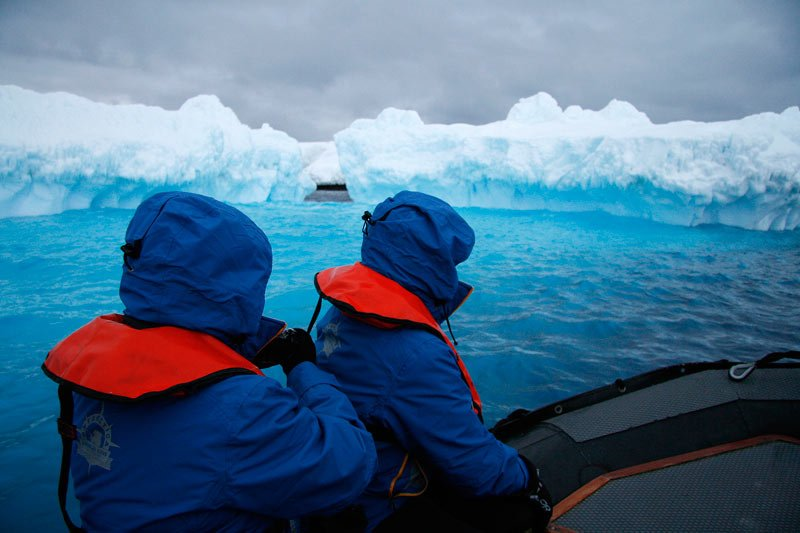 On a Zodiac cruise at dusk in the Weddell Sea, these icebergs in Antarctica seem to radiate a bright blue light