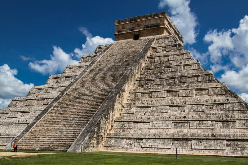 The 100-foot-high El Castillo dominates the ruins of Chichen Itza
