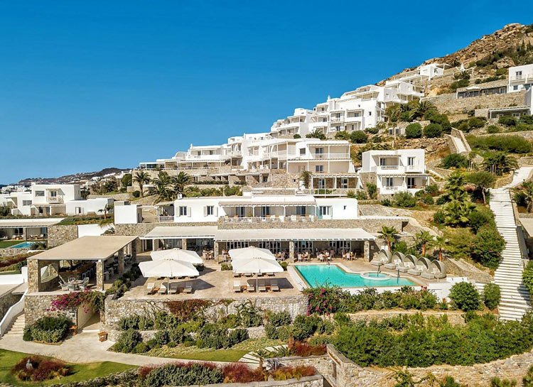 Rooms and suites at Santa Marina Resort are clustered in whitewashed buildings built on a hillside overlooking the sea
