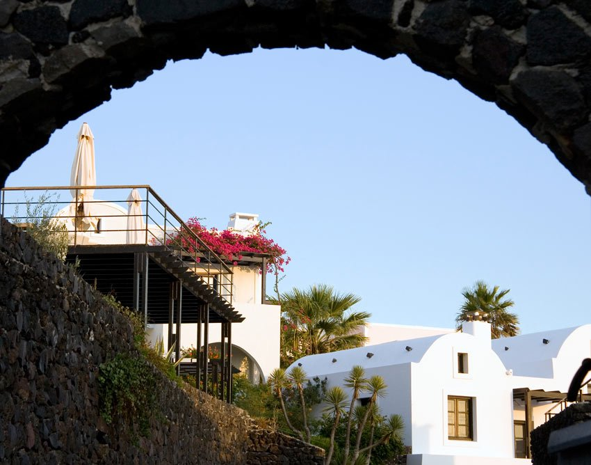 Stone arches and bougainvillea are part of Vedema's charm