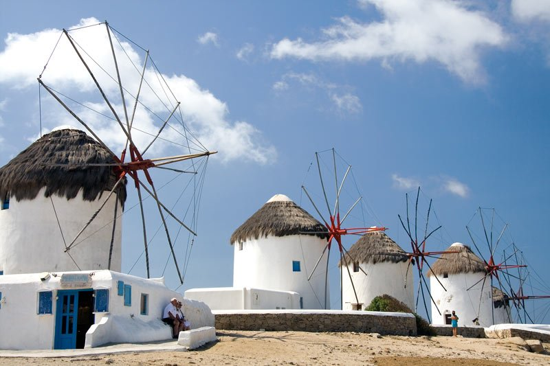 The iconic windmills of Mykonos stand watch over the town