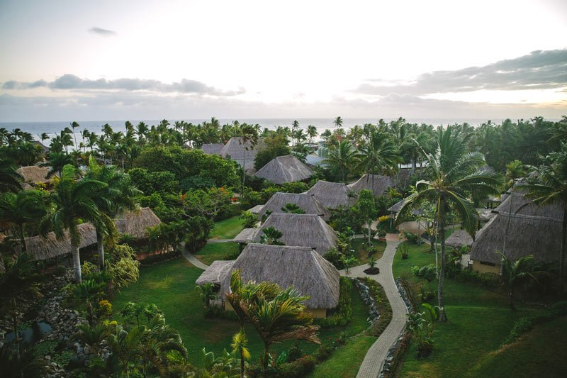 Modern Fiji bungalows by the sea at the Outrigger Fiji Beach Resort