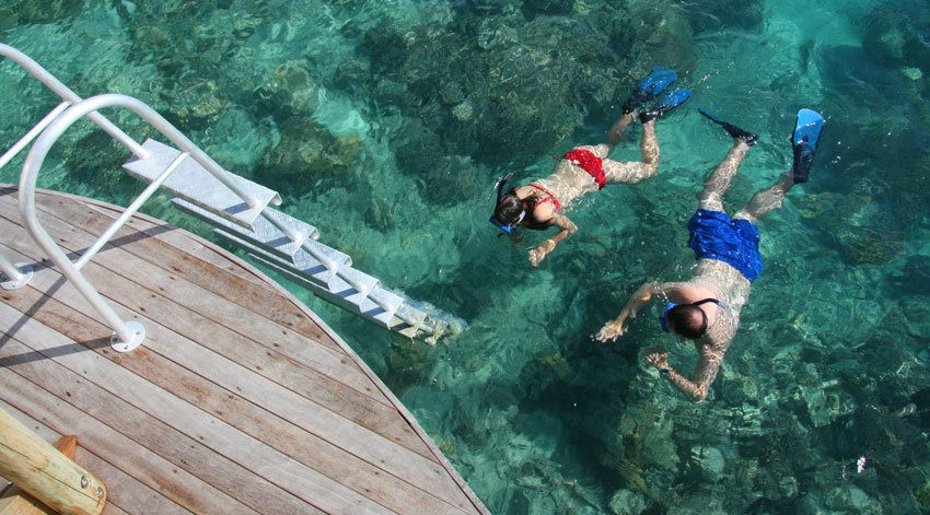 A couple snorkels near our Likuliku overwater bungalow