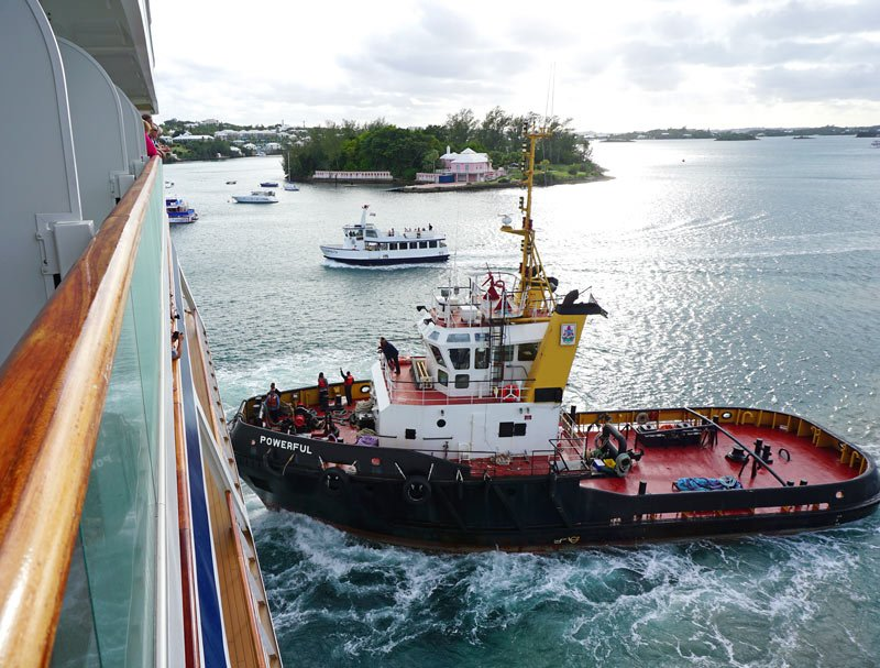 A tugboat gives the Viking Sea an assist to get into Bermuda's Hamilton harbor