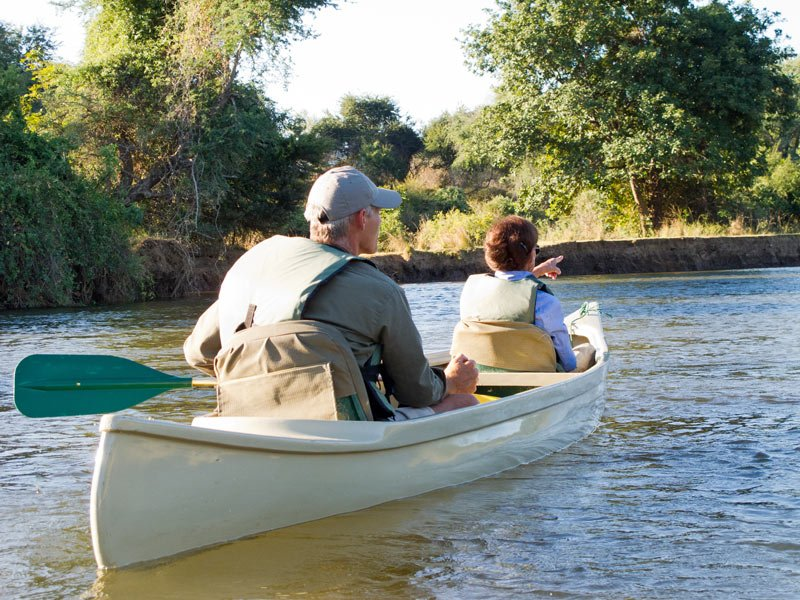 Ahhh! We're following this canoe on the croc-filled Zambezi River!