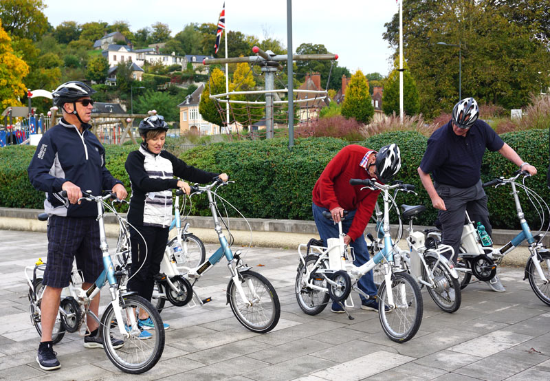 Guests get ready to ride e-bikes on a Scenic Cruises' excursion in France