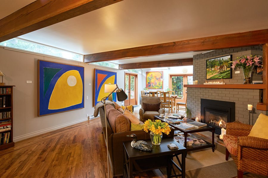 The open living room and dining area of Hedgerow House is filled with art by Salt Spring artists.