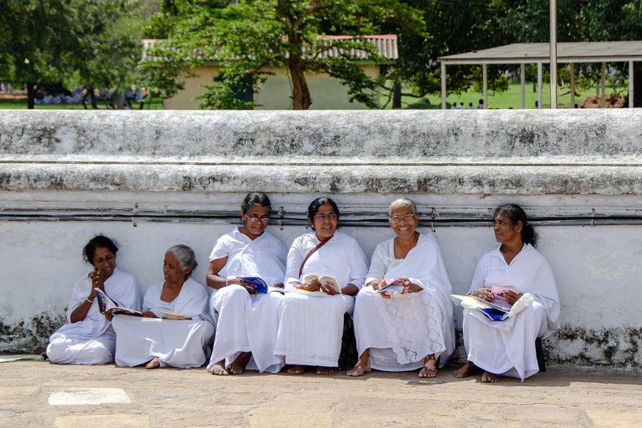 Buddhist worshippers in Kandy, Sri Lanka