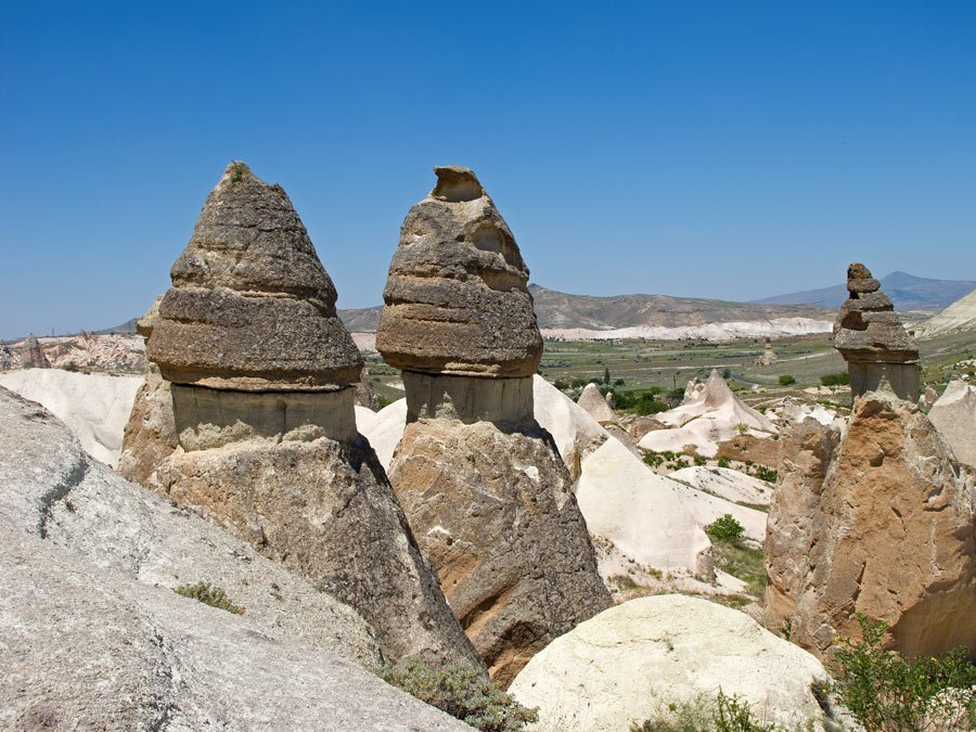 "These tall rock pinnacles in Cappadocia are known as ""fairy chimneys"""