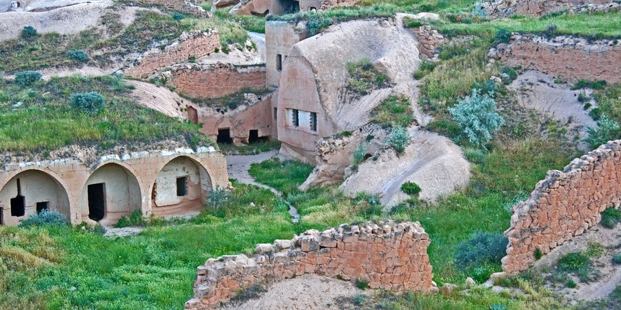 Ancient rock cave houses we fly over on our Cappadocia balloon ride