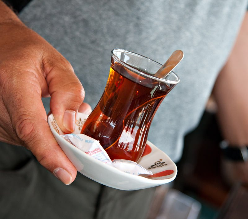 We drink tea from tulip-shaped glasses onboard our Bosphorus ferry cruise