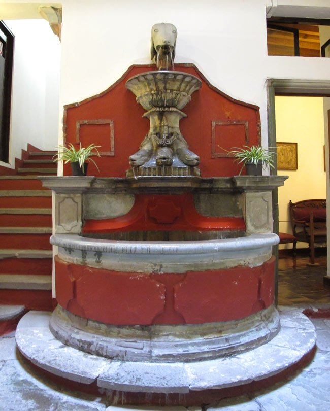 A fountain sits in an atrium courtyard in the center of the Diego Rivera House Museum