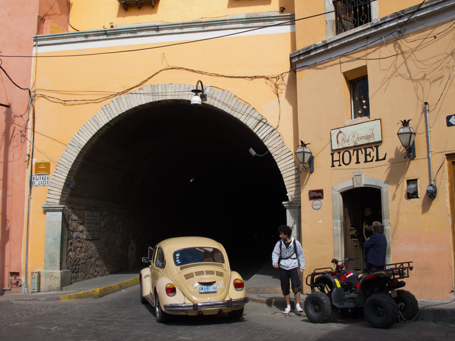 Cars drive through a maze of tunnels underneath Guanajuato's historic center.
