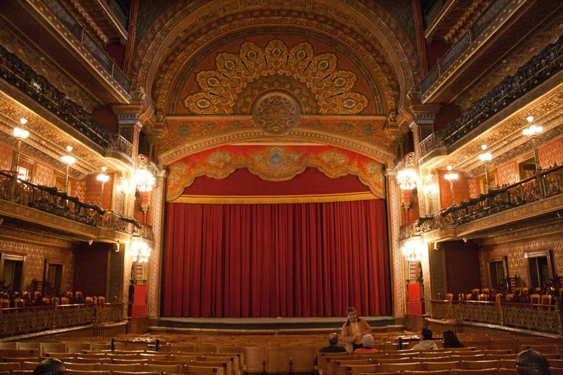 The ornate interior of the Juarez Theater, Guanajuato, is ablaze in red and gold colors.