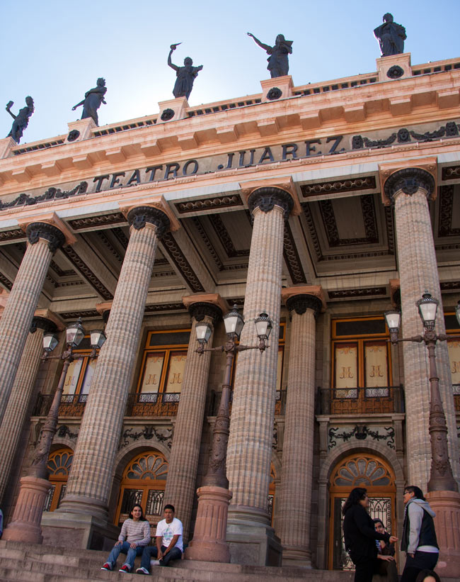 The stone façade of the Juarez Theater is dominated by 12 neoclassical Doric columns.