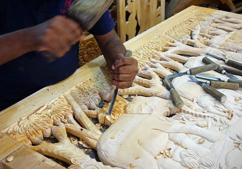 Wood carvers at work at Oak Ray Wood Carvings in Kandy